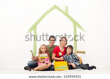 Family with two kids repainting their home - redecorating together - stock photo