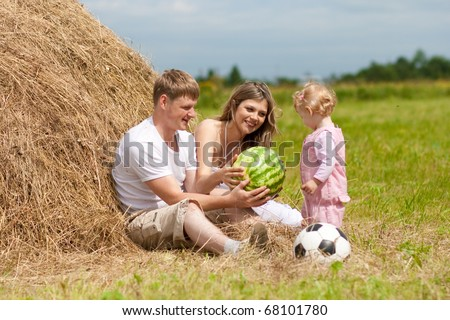 family with watermelon outdoor - stock photo