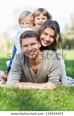 Family with young children in the park