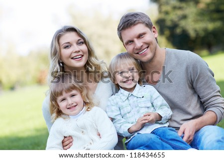 Family with young children in the park - stock photo