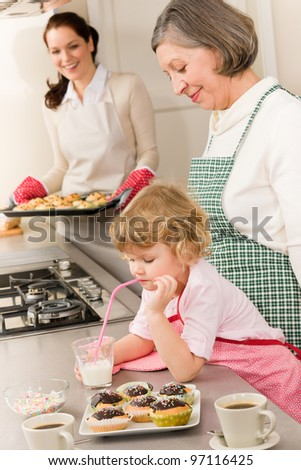 Family women baking cupcakes in kitchen grandmother, mother and granddaughter