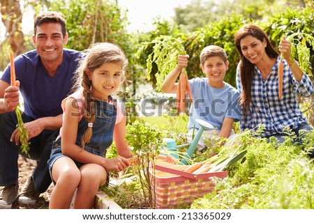 Family Working On Allotment Together - stock photo