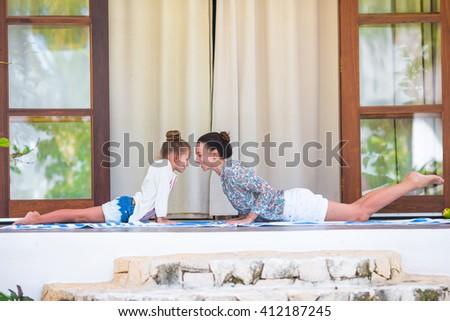 Family yoga exercise outdoors - stock photo