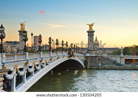 famous Alexandre III Bridge at sunset in  Paris, France - stock photo