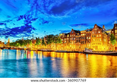 Famous Amstel river and night view of beautiful Amsterdam city. Netherlands - stock photo