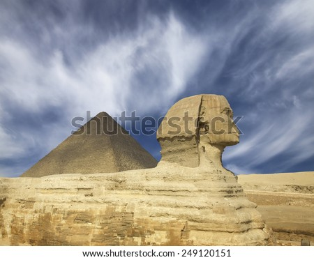 Famous ancient egypt Cheops pyramid and sphinx in Giza Cairo - stock photo
