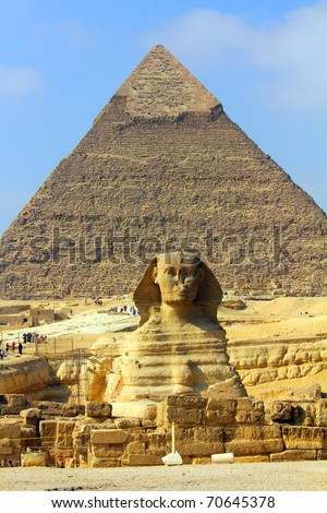 famous ancient egypt pyramid and sphinx in Giza - stock photo