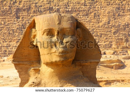 famous ancient egypt sphinx face and pyramid in Giza - stock photo