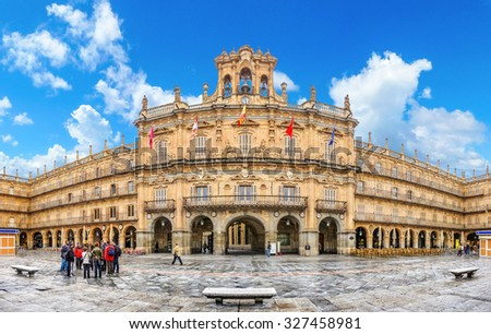 Famous and historic  Plaza Mayor in Salamanca on a sunny day with dramatic clouds, Castilla y Leon, Spain - stock photo