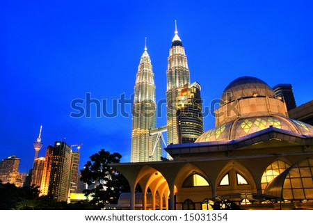 Famous Asy-Syakirin Mosque with Petronas Towers at the background, Kuala Lumpur, Malaysia - stock photo