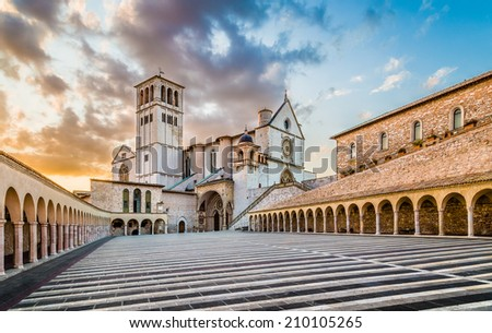 Famous Basilica of St. Francis of Assisi (Basilica Papale di San Francesco) with Lower Plaza at sunset in Assisi, Umbria, Italy - stock photo