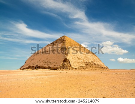 Famous Bent Pyramid under puffy clouds, Dahshur, Egypt - stock photo