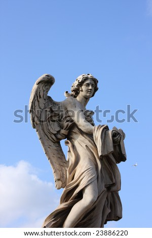 famous Bernini angel sculpture on San Angelo bridge in Rome,Italy