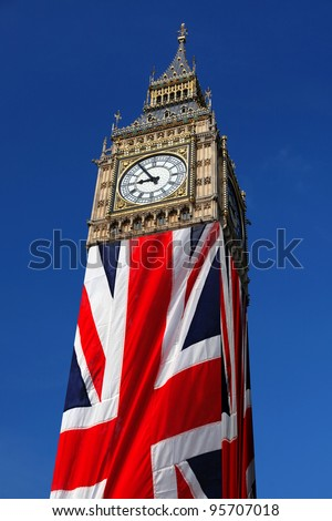 Famous Big Ben with flag of England in London - stock photo