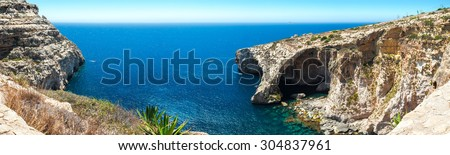 Famous Blue Grotto in Malta near Zurrieq on a calm sunny day. Horizontal panorama from 5 vertical frames. - stock photo