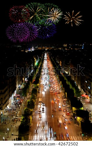 Famous boulevard Champs Elysees in Paris, France and celeberation fireworks - stock photo
