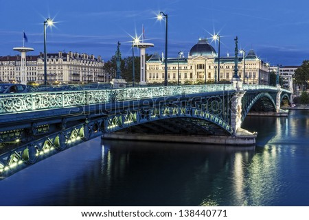 Famous bridge and University in Lyon by night - stock photo