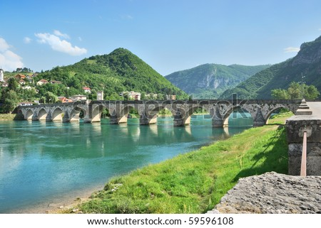 Famous bridge on the Drina in Visegrad, Bosnia and Herzegovina, on a hot summer day. - stock photo