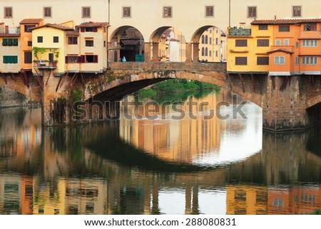 famous bridge Ponte Vecchio with reflection, Florence, Italy - stock photo