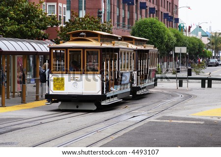 Famous cable car in San Francisco in motion - stock photo