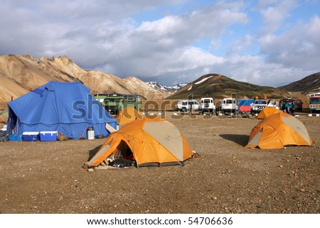 Famous campground in Landmannalaugar - mountain area in Iceland. Colorful tents. - stock photo