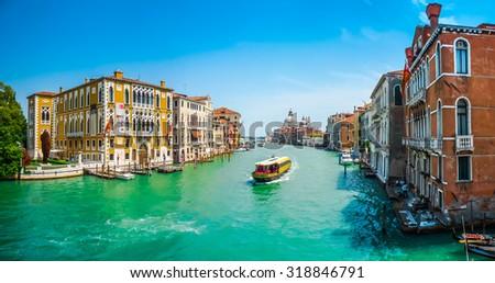 Famous Canal Grande with Basilica di Santa Maria della Salute in Venice, Italy - stock photo