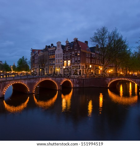 famous canals and bridgres  of Amsterdam in night, Netherlands - stock photo