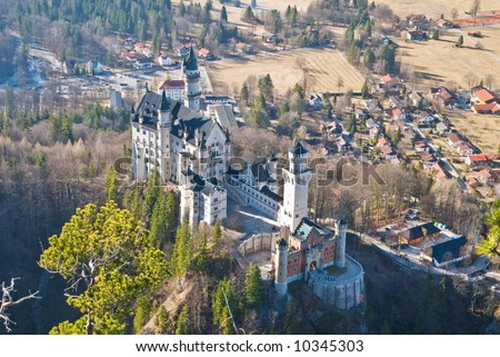 Famous castle Neuschwanstein. Bavaria, Germany. Birds-eye view from a mountain. - stock photo