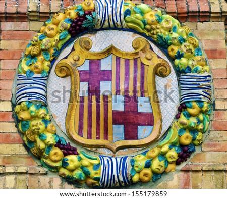 Famous ceramic decoration in Plaza de Espana, Sevilla, Spain. Coat of Barcelona.  - stock photo