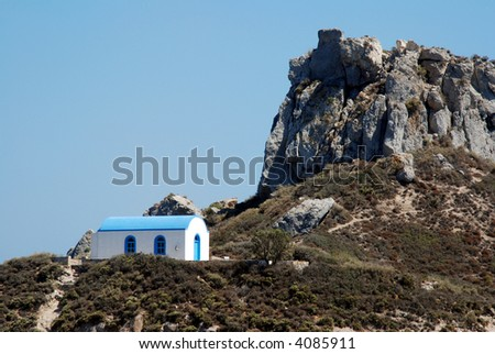 Famous chapel on a Castri isle in Kefalos bay on e greek island Kos - stock photo
