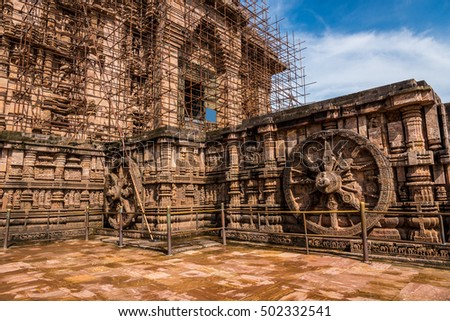 Famous chariot wheel at Konark and iron rods supporting the ruins of the Sun temple.