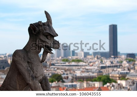 Famous Chimera (demon) overlooking the Montparnasse Tower from Notre Dame of Paris - stock photo