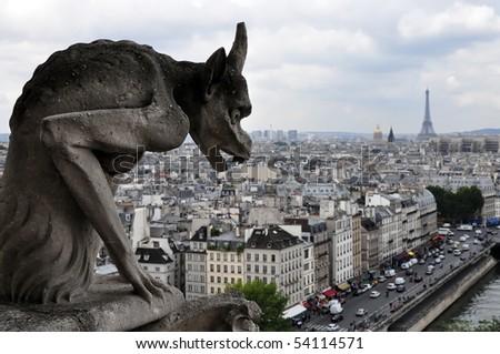 Famous chimere of Notre-Dame overlooking Paris. Notre Dame de Paris, Paris, Europe - stock photo