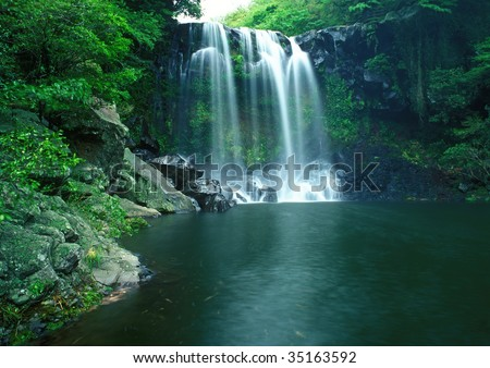 Famous Chunjeyun Waterfall of Jeju island in South Korea. - stock photo