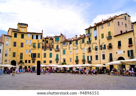 Famous circular Piazza dell'Anfiteatro in the Tuscan city of Lucca - stock photo