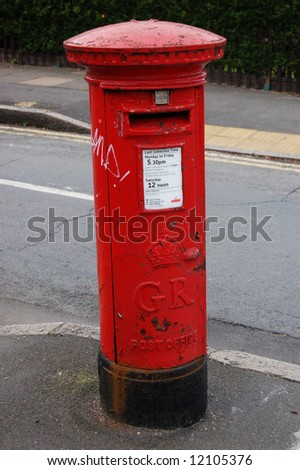 Famous classic red London post office on the street - stock photo