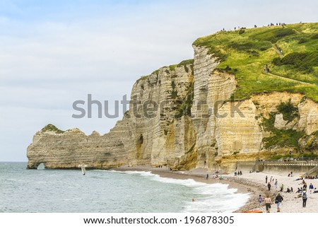 "Famous cliffs ""d�Amont"" of Etretat. Etretat is a commune in the Seine-Maritime department in the Haute-Normandie region in northwestern France. Etretat is now a famous French seaside resort. - stock photo"