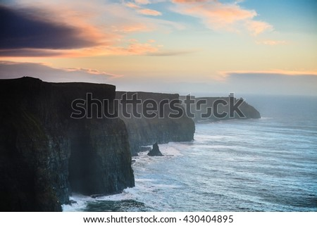 Famous cliffs of Moher at sunset in Co. Clare Ireland Europe. Beautiful landscape natural attraction. - stock photo