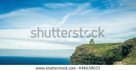 famous cliffs of moher, castle tower, west coast of ireland at wild atlantic ocean - stock photo