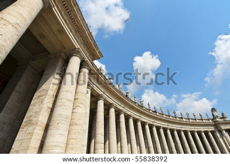 Famous colonnade of St. Peter's Basilica in Vatican - stock photo
