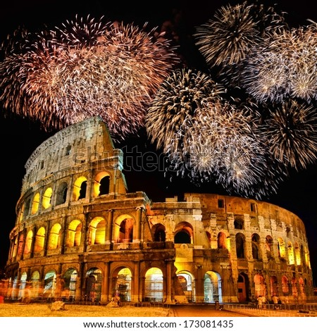 Famous Colosseum of Rome, Italy at night with fireworks - stock photo