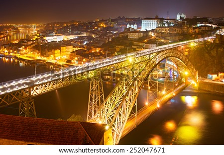 Famous Dom Luis I bridge at night. Old Town of Porto on the background. Portugal