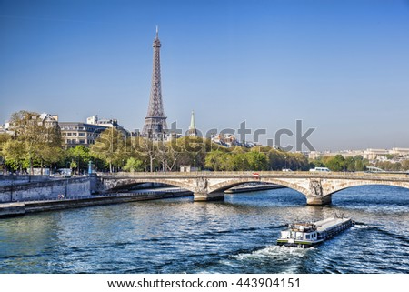 Famous Eiffel Tower with boat on Seine in Paris, France