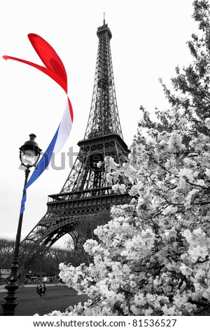 Famous Eiffel Tower with colorful flag in Paris, France - stock photo
