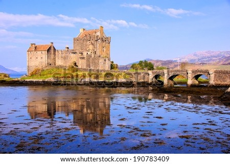 Famous Eilean Donan Castle in the highlands of Scotland with reflections - stock photo