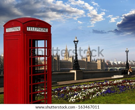 Famous English red telephone box with Big Ben in London, UK