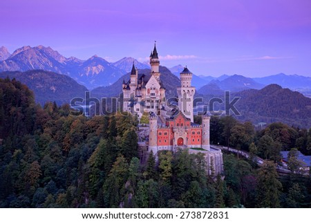 Famous fairy tale Neuschwanstein Castle in Bavaria, Germany, before sunrise - stock photo