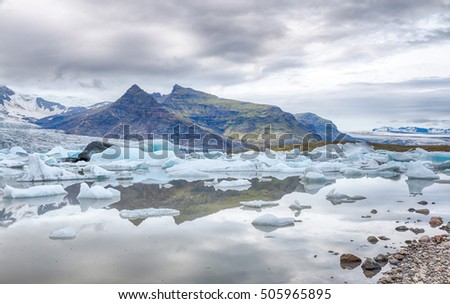 Famous Fjallsarlon glacier and lagoon with icebergs swimming on the water, close to Jokulsarlon, southern Iceland, HDR version