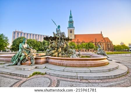 Famous fountain on Alexanderplatz in Berlin - Germany - stock photo