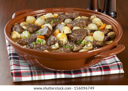 ... cooked in red wine with onions, mushrooms, bacon and carrots. - stock